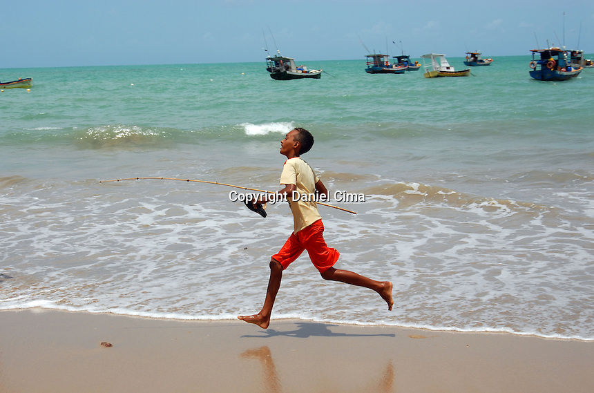 Teenager running at the beach in Joao Pesoa, Brazil