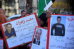 Palestinians from a human chain hold banners during a rally to show solidarity with the Palestine's martyrs of the Intifada Jerusalem , in the West Bank city of Ramallah, on January 16, 2016. This has brought the number of Palestinians who have been killed by Israeli forces since the Jerusalem Intifada to 160 martyrs. In addition, over 15,000 Palestinians got injured. Photo by Shadi Hatem