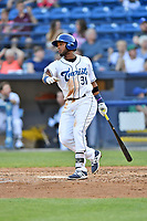 Asheville Tourists first baseman Luis Castro (31) swings at a pitch during a game against the West Virginia Power at McCormick Field on May 10, 2017 in Asheville, North Carolina. The Tourists defeated the Power 4-3. (Tony Farlow/Four Seam Images)