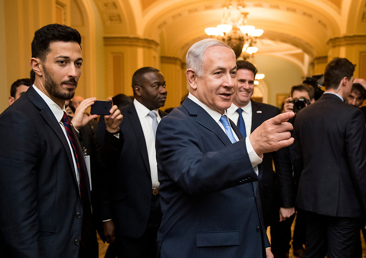 UNITED STATES - MARCH 6: Prime Minister of Israel Benjamin Netanyahu stops in the Ohio Clock Corridor of the U.S. Capitol to speak with Senate staff and journlists as he made his way to Speaker of the House Paul Ryan's office on Tuesday, March 6, 2018. (Photo By Bill Clark/CQ Roll Call)