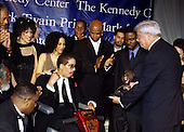 1998 Mark Twain Comedy Prize honoree Richard Pryor with daughters Rain (left) and Elizabeth receives the award on October 20, 1998.  Also in the photo behind Mr. Pryor are Morgan Freeman, Danny Glover, Damon Wayans, and Chris Rock.  .Credit: James Kelly / Pool via CNP