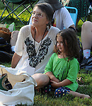 Lyn Hardy, sitting in the audience with her granddaughter, Opal Merenda, on Hoot Hill, on third-and-final day of the 4th Annual Summer Hoot Festival, held at the Ashokan Center in Olivebridge, NY, on Sunday, August 28, 2016. Photo by Jim Peppler; Copyright Jim Peppler 2016.