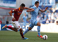 Calcio, finale di Coppa Italia: Roma vs Lazio. Roma, stadio Olimpico, 26 maggio 2013..Lazio forward Miroslav Klose, of Germany, is challenged by AS Roma defender Leandro Castan, of Brazil, left, during the Italian Cup football final match between AS Roma and Lazio at Rome's Olympic stadium, 26 May 2013..UPDATE IMAGES PRESS/Isabella Bonotto....