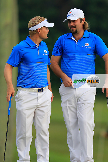 Soren Kjeldsen (DEN) and Victor Dubuisson (FRA) Team Europe on the 1st green during Match 1 of Friday's Fourball Matches of the 2016 Eurasia Cup presented by DRB-HICOM, held at the Glenmarie Golf &amp; Country Club, Kuala Lumpur, Malaysia. 15th January 2016.<br /> Picture: Eoin Clarke | Golffile<br /> <br /> <br /> <br /> All photos usage must carry mandatory copyright credit (&copy; Golffile | Eoin Clarke)