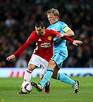 Henrikh Mkhitaryan of Manchester United takes on Dirk Kuyt of Feyenoord during the UEFA Europa League match at Old Trafford, Manchester. Picture date: November 24th 2016. Pic Matt McNulty/Sportimage