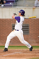 Austin Homan #30 of the East Carolina Pirates follows through on his swing versus the Elon Phoenix at Clark-LeClair Stadium March 29, 2009 in Greenville, North Carolina. (Photo by Brian Westerholt / Four Seam Images)
