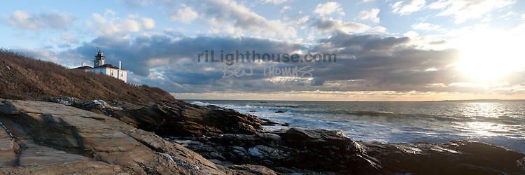 Waves glisten under the setting sun by the Beavertail Lighthouse.