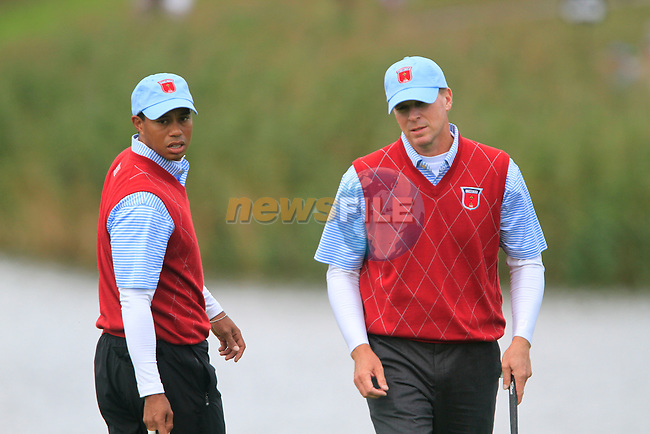 Tiger Woods and Steve Stricker line up their putt on the 13th green in Match 1 of the Session 3 Foursomes and Fourball Matches during Day 3 of the The 2010 Ryder Cup at the Celtic Manor, Newport, Wales, 3rd October 2010..(Picture Eoin Clarke/www.golffile.ie)