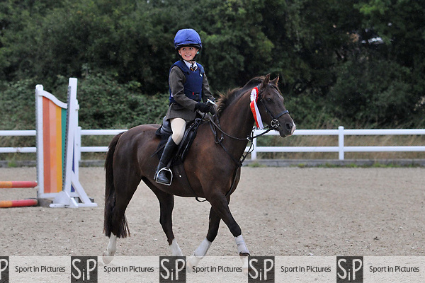 Stapleford Abbotts. United Kingdom. 18 August 2019. Class 1. Unaffiliated showjumping. Brook Farm training centre. Essex. UK.~ 18/08/2019.  MANDATORY Credit Ellen Szalai/Sport in Pictures - NO UNAUTHORISED USE - 07837 394578