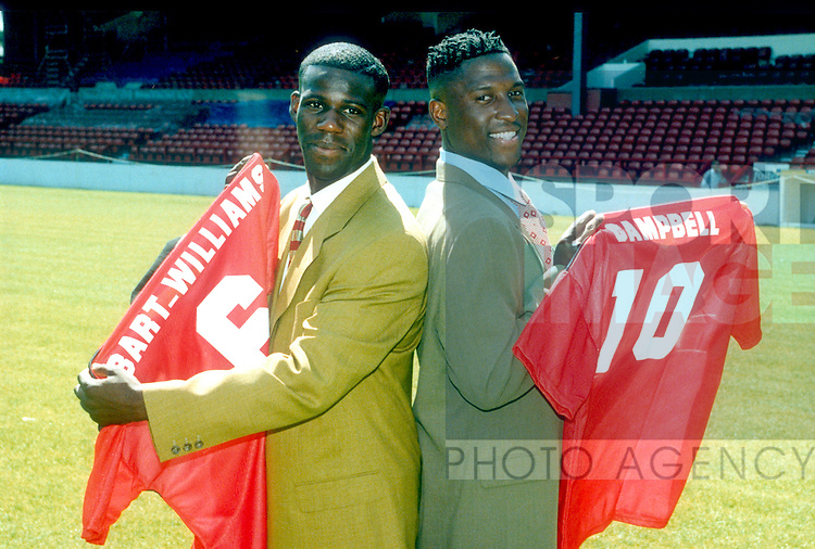 Nottingham forest new signings Chris Bart Williams and Kevin Campbell pose with their shirts during a press conference at the City ground, Nottingham, England 1995