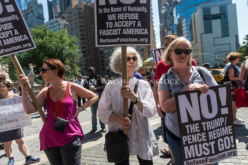 New York, NY 13 August 2017 - Fire & Fury - Anti - trump protesters gathered in Columbus Circle, across from Trump Hotel And Towers, to speakout against President Trump's threats against North Korea speak out against facism and the Alt Right, and remember those killed in Charlottesville, VA. ©Stacy Walsh Rosenstock