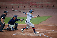 Jacksonville Jumbo Shrimp Corey Bird (32) at bat in front of catcher Jack Kruger and umpire Mark Stewart during a Southern League game against the Mobile BayBears on May 7, 2019 at Hank Aaron Stadium in Mobile, Alabama.  Mobile defeated Jacksonville 2-0.  (Mike Janes/Four Seam Images)