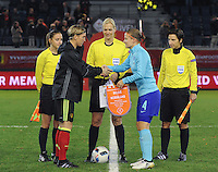 20161124 - LEUVEN ,  BELGIUM : Hand Shake between Aline zeler (L) and Mandy Van Den Berg (R) with referee Bibiana Steinhaus (M) and assistant referees Katrin Rafalski (R)  Imke Lohmeyer (L)   pictured during the female soccer game between the Belgian Red Flames and The Netherlands , a friendly game before the European Championship in The Netherlands 2017  , Thursday 24 th November 2016 at Stadion Den Dreef  in Leuven , Belgium. PHOTO SPORTPIX.BE | DIRK VUYLSTEKE