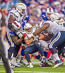 21 September 2014: San Diego Chargers running back Donald Brown holds onto the ball as he is tackled by the Buffalo Bills at Ralph Wilson Stadium in Orchard Park, NY. The Chargers defeated the Bills 22-10 in AFC play. Mandatory Credit: Ed Wolfstein Photo *** RAW (NEF) Image File Available ***