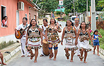 Tikuna indigenous dance in the street of their neighborhood in Manaus, Brazil. Tikuna families started moving to the city in the 1980s from their forest villages in the Alto Solimoes region of the Amazon. Beginning in the 1990s they centered their life in the Cidade de Deus neighborhood. With assistance from the Catholic Church's Indigenous Mission Council, known as CIMI, they formed the Wotchimaucu Community, today a center for Tikuna culture and for Tikuna newcomers migrating to the city. Dancing is one part of a community struggle to keep indigenous culture alive in the urban setting.
