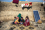 8 December 2013, Hemandi Market, Kabul Province, Afghanistan:  Gul Juma and her children squat in the mud of their shelter in the refugee camp at Helmandi Market on the outskirts of Kabul, Afghanistan. They are refugees from Uruzgan Province where Australian forces are winding up their long Afghan deployment before Christmas.  Gul's husband was killed in an air strike and along with many others has fled the area where retribution for those that helped coalition forces may be meted out after the withdrawal. Conditions in the camp are harsh and with winter snows approaching many are ill and short of food and medicines.    Picture by Graham Crouch