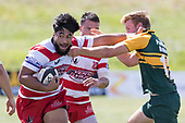 Cardiff Vaega attempts to fend off Josh Baverstock as he makes a run through the midfield. Counties Manukau Premier Counties Power Club Rugby game between Karaka and Pukekohe, played at the Karaka Sports Park on Saturday March 10th 2018. Pukekohe won the game 31 - 27 after trailing 5 - 20 at halftime.<br /> Photo by Richard Spranger.