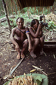A-Ukre, Brazil. Mote, a Kayapo Indian chief, with his wife holding a Nikon professional camera in an relaxed, unguarded moment. Para State.