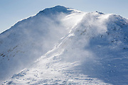 Strong winds blow snow off the summit of Mount John Quincy Adams in the Presidential Range of the New Hampshire White Mountains during the winter months. This sub-peak of Mount Adams is named after President John Quincy Adams.