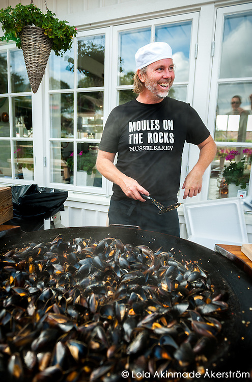 Fisherman Janne Bark cooking his signature Moules Frites mussel pot.