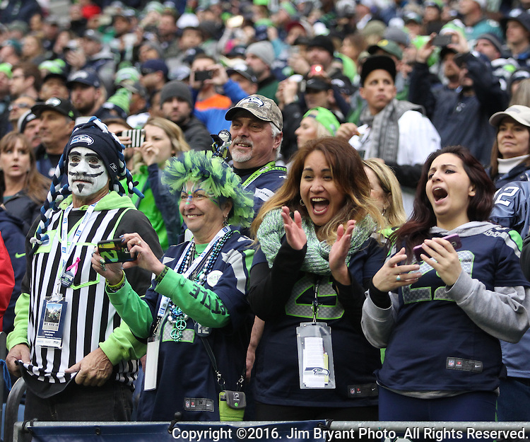Seattle Seahawks fans cheer during a first quarter touchdown made against the Philadelphia Eagles<br /> at CenturyLink Field in Seattle, Washington on November 20, 2016.  Seahawks beat the Eagles 26-15.   &copy;2016. Jim Bryant Photo. All Rights Reserved.