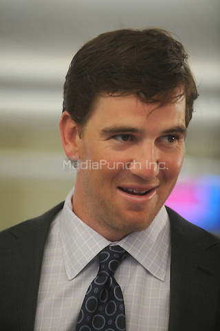 Eli Manning at BTIG's 9th annual Commissions for Charity day on April 27, 2011 in New York City. Credit: Dennis Van Tine/MediaPunch