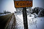 Niegowa 01.2010 Poland<br /> &quot;The End&quot; Road sign.<br /> Three atmospheric forces: rain, snow and frost have changed into an ecological disaster the Myszkowski district in the Czestochowskie province, located 230 kilometers south of Warsaw. Almost 95% of all trees are down.Thousands of homes are left without electricity.<br /> Photo: Adam Lach / Napo Images for Newsweek Polska<br /> <br /> Zamarzniety krzyz na drodze w pow.myszkowskim.<br /> Wstepnie &quot;tylko&quot; 95% scietych drzew w dwoch powiatach. 0.5 miliona metrow szesciennych zniszczonych lasow..Tysiace gospodarstw bez pradu. Wszyscy maja swiadomosc, ze na kumulacje trzech niekorzystnych .zjawisk atmosferycznych rady nie ma.Trzy zjawiska kt&oacute;re zamienily jeden z obszarow Polski w istna katastrofe ekologiczna: deszcz, snieg i szadz.<br /> Fot: Adam Lach / Napo Images dla Newsweek Polska