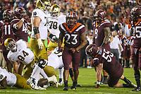 Blacksburg, VA - October 6, 2018: Virginia Tech Hokies linebacker Rayshard Ashby (23) celebrates after making a tackle during the game between Notre Dame and VA Tech at  Lane Stadium in Blacksburg, VA.   (Photo by Elliott Brown/Media Images International)