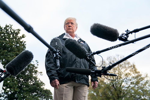 U.S. President Donald J. Trump speaks to the media before he departs the White House for California, where he is scheduled to view damage from that state's wildfires, in Washington, DC, USA, 17 November 2018. Seventy-four people have been killed and more than 1,000 people are missing due to multiple devastating fires across the state. The President spoke about the investigation into Jamal Khashoggi's murder, the Mueller investigation, and the migrant caravan approaching the southern border.<br /> Credit: Jim LoScalzo / Pool via CNP