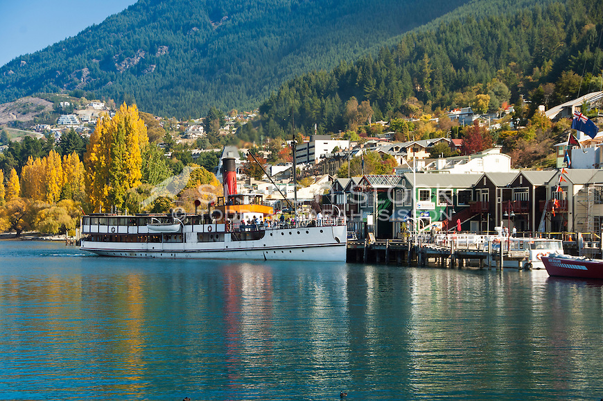 Tourists aboard the Earnslaw steamer ship at Steamer Wharf on an Autumn Day in Queenstown, Central Otago, South Island, New Zealand