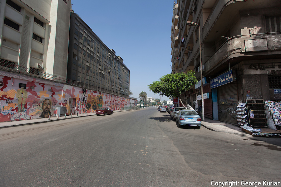 Downtown Cairo wore a deserted look with hardly any traffic on Mohamad Mahmud St leading to Tahrir Square. Revolution graffiti lines the wall of the American University of Cairo, commemorating the many killed in the violence.