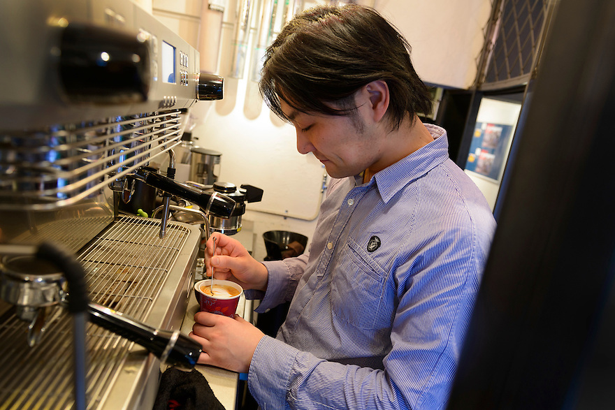Susumu Fujimiya, staff at Ballon d'Essai coffee shop, making a coffee with the face of the photographer. Shimokitazawa, Tokyo, Japan, November 1, 2012. Shimokitazawa is a fashionable area popular with students and packed with cool bars, restaurants, shops and music venues.