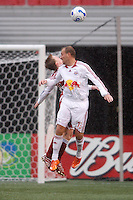 Red Bulls midfielder (13) Clint Mathis goes up for a header. The Red Bulls defeated FC Dallas 3-0 at Giants Stadium, East Rutherford, NJ, on April 15, 2007.