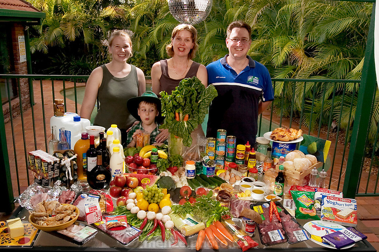 (MODEL RELEASED IMAGE).The Molloy family: John, 43, Natalie, 41, Emily, 15 (called Em), and Sean, 5 (wearing his school uniform, including a hat for sun protection)on the backyard patio by their pool in Brisbane, on Australia's east coast, with one week's worth of food, in January. The Molloy family is one of the thirty families featured in the book Hungry Planet: What the World Eats (p. 30).