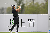 Graeme McDowell (NIR) tees off the 12th tee during Friday's Round 2 of the 2014 BMW Masters held at Lake Malaren, Shanghai, China 31st October 2014.<br /> Picture: Eoin Clarke www.golffile.ie