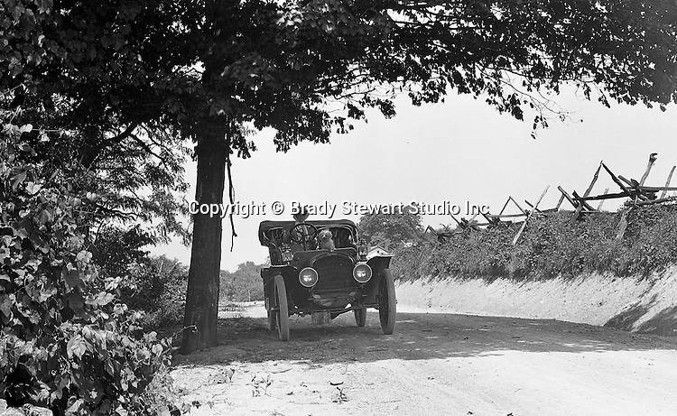 Westmoreland County PA:  Woman and dog riding in a 1905 Model B automobile on the Greensburg turnpike - 1906