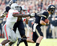Ohio State Buckeyes defensive lineman Noah Spence (8) grabs Purdue Boilermakers quarterback Danny Etling (5) from behind during the first half of the NCAA football game at Ross-Ade Stadium in West Lafayette, Ind. on Nov. 2, 2013. (Adam Cairns / The Columbus Dispatch)