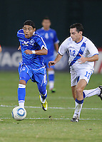 El Salvador forward Cristian Castillo (12) goes against Guatemalan midfielder Carlos Figueroa (12)  The Guatemalan National Team defeated  El Salvador National Team 2-0 in a friendly international at RFK Stadium, Saturday September 7, 2010.