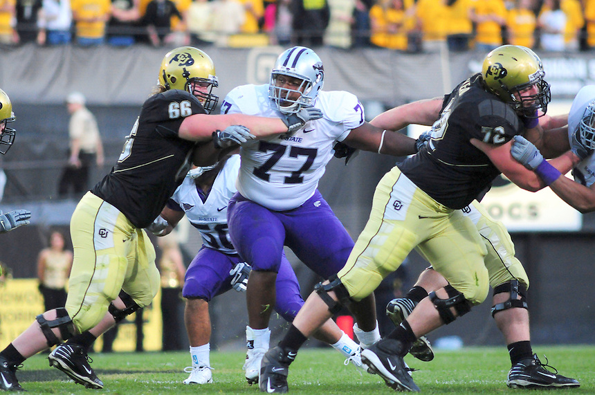 18 October 08: Kansas State nose tackle Daniel Calvin works against Colorado center Blake Behrens (66). Also working on the play is Colorado guard Devin Head (72). The Colorado Buffaloes defeated the Kansas State Wildcats 14-13 at Folsom Field in Boulder, Colorado.
