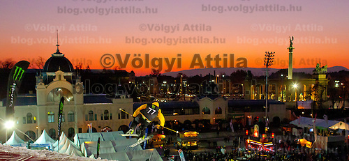 Ole Mustard from Norway performs his trick during the freestyle skiing competition held on the 35 meters high artificial ski jumping ramp on the Monster Energy Fridge Festival in central Budapest, Hungary on November 12, 2011. ATTILA VOLGYI