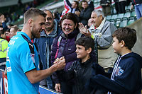 Fleetwood Town's  Ashley Eastham celebrates with fans and family after a 2-0 victory over Plymouth Argyle<br /> <br /> Photographer Andrew Kearns/CameraSport<br /> <br /> The EFL Sky Bet League One - Plymouth Argyle v Fleetwood Town - Saturday 7th October 2017 - Home Park - Plymouth<br /> <br /> World Copyright &copy; 2017 CameraSport. All rights reserved. 43 Linden Ave. Countesthorpe. Leicester. England. LE8 5PG - Tel: +44 (0) 116 277 4147 - admin@camerasport.com - www.camerasport.com