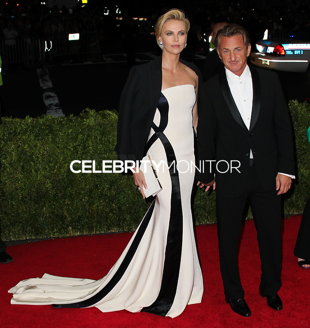 "NEW YORK CITY, NY, USA - MAY 05: Charlize Theron, Sean Penn at the ""Charles James: Beyond Fashion"" Costume Institute Gala held at the Metropolitan Museum of Art on May 5, 2014 in New York City, New York, United States. (Photo by Xavier Collin/Celebrity Monitor)"