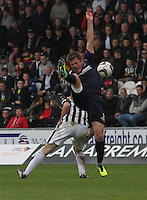 Richie Brittain goes over the top of John McGinn in the St Mirren v Ross County Scottish Professional Football League Premiership match played at St Mirren Park, Paisley on 3.5.14.