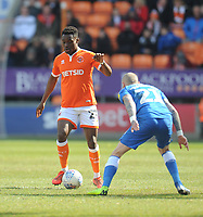 Blackpool's Marc Bola under pressure from Peterborough United's Marcus Maddison<br /> <br /> Photographer Kevin Barnes/CameraSport<br /> <br /> The EFL Sky Bet League One - Blackpool v Peterborough United - Saturday 13th April 2019 - Bloomfield Road - Blackpool<br /> <br /> World Copyright &copy; 2019 CameraSport. All rights reserved. 43 Linden Ave. Countesthorpe. Leicester. England. LE8 5PG - Tel: +44 (0) 116 277 4147 - admin@camerasport.com - www.camerasport.com