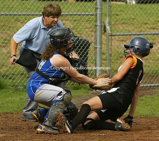 TERRYVILLE, CT 5/11/07- 051107BZ10-  Shepaug's Megan Piersall (10) makes the tag at home on Terryville's Sharon Mierzejewski (1) as home plate umpire Cyndie Adamski keeps her eyes on the action.<br /> Jamison C. Bazinet Republican-American