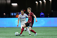 ATLANTA, GA - MARCH 07: ATLANTA, GA - MARCH 07: Atlanta United defender Laurence Wyke passes the ball during the match against FC Cincinnati, which Atlanta won, 2-1, in front of a crowd of 69,301 at Mercedes-Benz Stadium during a game between FC Cincinnati and Atlanta United FC at Mercedes-Benz Stadium on March 07, 2020 in Atlanta, Georgia.