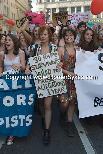 Slut Walk London June 11 2011.  Lisa Longstaff with banner 30 Rape Survivors, and 17yrs old sixth former Anastasia Richardson who started the London Slutwalk protest.