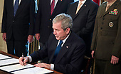 United States President George W. Bush sings a proclamation in the Oval Office of the White House December 5, 2008 in Washington, DC.  Bush signed two proclamations honoring World War II's Pacific theater.  <br /> Credit: Brendan Smialowski / Pool via CNP