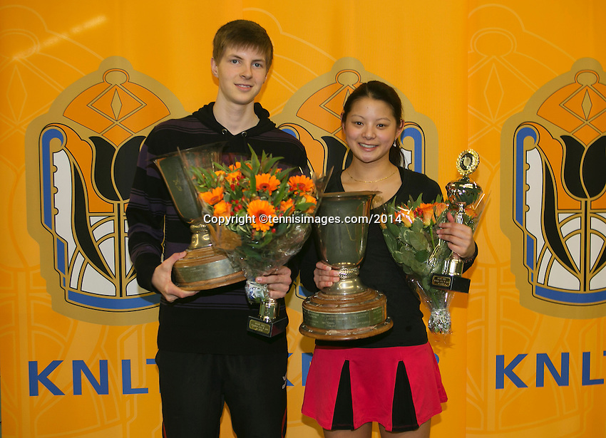 Rotterdam, The Netherlands, 15.03.2014. NOJK 14 and 18 years ,National Indoor Juniors Championships of 2014, Trophy giving on court, winner boys 18 years Gijs Brouwer and winner  girls 18 years Arianne Hartono  .<br /> Photo:Tennisimages/Henk Koster