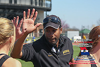 Mizzou assistant track coach Derrick Peterson congratulates Leslie Farmer with a hi-five after the women's 4x400-meter relay at the Tom Botts Invitational, Saturday, April 11, 2009 at Audrey Walton Stadium, in Columbia, MO.